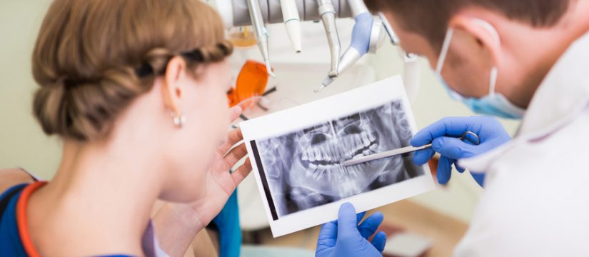 dentists looking at patient xray